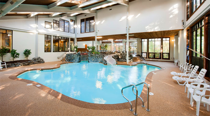 The large indoor pool and waterslide at The Summit Resort's 25,000 square foot amenities center